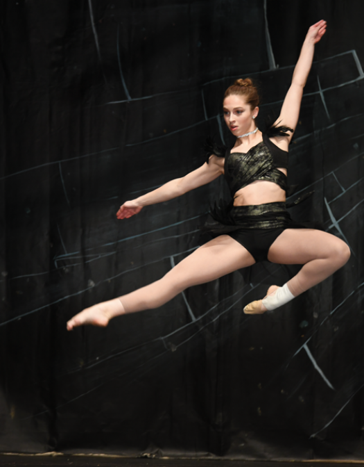 Teen dancer practising and raising funds for international competition